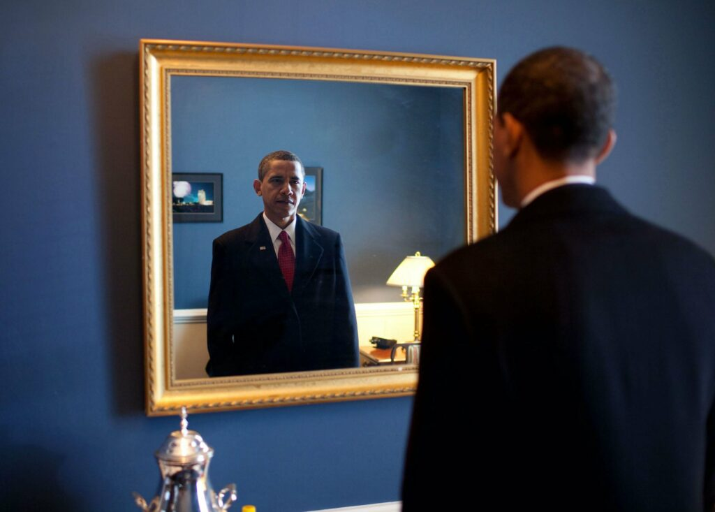 Barack Obama looking into a mirror